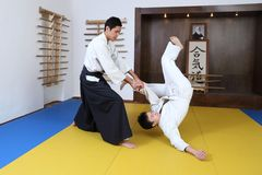 Demonstration of fighting art Aikido. In  sports hall (dodjo Royalty Free Stock Image