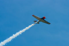 Demonstration flight of a single-engined advanced trainer aircraft North American T-6 Texan. Royalty Free Stock Image