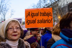 Demonstration on International Women's Day 2016 in Madrid, Spain. A placard in Spanish against gender based pay. Demonstrators marched from Atocha to Cibeles in Royalty Free Stock Photography