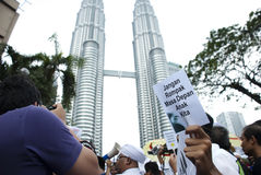 Demonstration in Kuala Lumpur. MALAYSIA-MAY 20: An activist holds a placard during a protest against a proposed rare earth plant to be built in Gebeng, in front Stock Photo