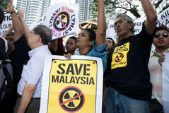 Demonstration in Kuala Lumpur, Malaysia. KUALA LUMPUR, MALAYSIA-MAY 20: Demonstrators holds poster during a protest against a proposed rare earth plant to be Royalty Free Stock Photos