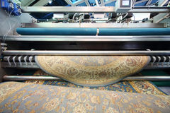 Demonstration of machine that cleanswool carpet Royalty Free Stock Photography