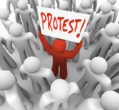 Demonstration Man Holds Protest Sign Movement for Change. A person holds a sign reading Protest to demonstrate a complain and rally for change and revolution to Stock Photos