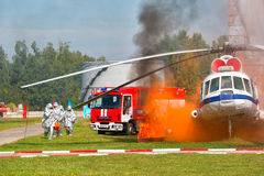 Demonstration performances of rescuers of Ministry of Emergency Situations of Russia. Fire extinguishing on aviation equipment royalty free stock photo