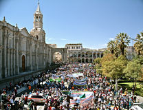 Demonstration on Plaza de Armas, Arequipa. Crowd of people demonstrating on Arequipa´s Plaza de Armas. On the left the famous Basilica Cathedral Stock Photo