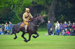 Demonstration of the sport of Tent Pegging at full gallop  by a member of the Punjab Lancers in World War One uniform Royalty Free Stock Photography