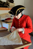 Demonstration of tailors work as she sews for a soldiers uniform, Fort Ticonderoga,New York,2015 Stock Photos