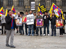 Demonstration for Tibet. Amsterdam, Netherlands - August 8, 2012: Demonstration against chinese invasion of Tibet in Dam Square, Amsterdam. About 100 people stock images