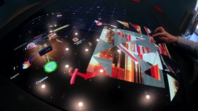 Demonstration of the touchscreen interactive table stock video footage