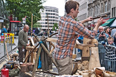 Demonstration of traditional wood turning methods. Members of the traditional Worshipful Company of Turners, demonstrate their craft using ancient methods.They Royalty Free Stock Photography