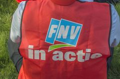 Backside Of A FNV Union Jacket With The Text FNV In Action At Amsterdam The Netherlands 2018. Demonstration Of Trigion Employees For A Better Collective stock photos