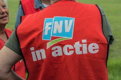 Backside Of A FNV Union Jacket With The Text FNV In Action At Amsterdam The Netherlands 2018. Demonstration Of Trigion Employees For A Better Collective royalty free stock photo