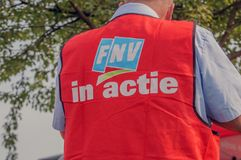Backside Of A FNV Union Jacket With The Text FNV In Action At Amsterdam The Netherlands 2018. Demonstration Of Trigion Employees For A Better Collective stock photography