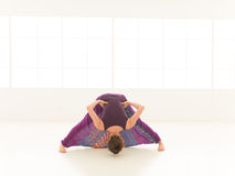 Demonstration of yoga pose indor Stock Images
