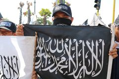 Demonstrations related to the burning of the Tawhid flag stock photos
