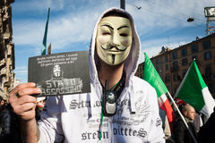 Demonstrator with Anonymous mask protesting against the government in Milan, Italy Royalty Free Stock Images