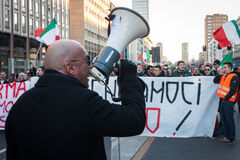 Demonstrator with loudhailer protesting against the government in Milan, Italy Stock Photo