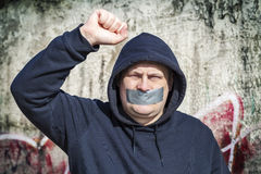 Demonstrator with a tape on a mouth Royalty Free Stock Image