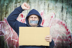 Demonstrator with a tape on a mouth Stock Photos