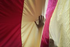 A demonstrator touch a giant estelada flag in central barcelona. A demonstrator touches a estelada flag, pro separatist catalan flag, during a demonstration pro Royalty Free Stock Images