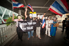 Demonstrators  from anti-government V for Thailand groups wear Guy Fawkes masks. Stock Photo