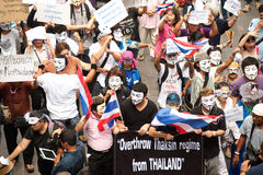 Demonstrators  from anti-government V for Thailand groups wear Guy Fawkes masks. Stock Image
