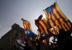Independence referendum in barcelona backlight. Demonstrators carry estelada flags, catalonia pro separatist flag, during a protest the day after the banned pro Royalty Free Stock Image