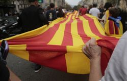 Referendum in barcelona. Demonstrators carry a huge estelada flag catalonia pro separatist flag during a protest the day after the banned pro independence Royalty Free Stock Photos