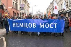Demonstrators carrying a big banner: Nemtsov Bridge on the Nemtsov memory march in Moscow. Moscow, Russia - February 24, 2019. Nemtsov memorial march stock images