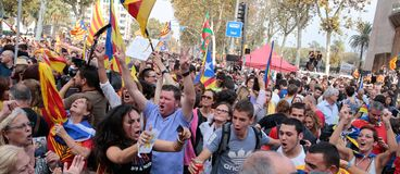 Demonstrators celebrating after the declaration of independence of catalonia in central barcelona. The crowd carry estelada flags, pro separatist catalan flag Royalty Free Stock Image