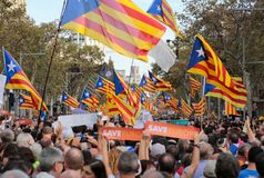 Demonstrators for freedom and against political prisoners in barcelona. The crowd carry estelada flags, pro separatist catalan flag, during a demonstration Stock Photography