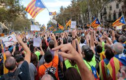 Demonstrators for freedom and against political prisoners in barcelona. The crowd carry estelada flags, pro separatist catalan flag, during a demonstration Royalty Free Stock Photos