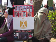 Demonstrators holding poster of casualties stock photography