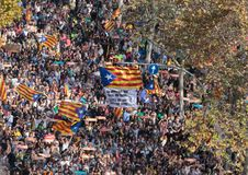 Demonstrators for independence in barcelona. The crowd carry estelada flags, pro separatist catalan flag, during a demonstration to hear the speech of the Stock Image
