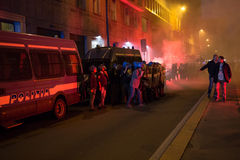 Demonstrators launching smoke canisters to police in front of the Turkish consulate in Milan, Italy Stock Images