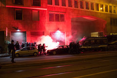 Demonstrators launching smoke canisters to police in front of the Turkish consulate in Milan, Italy Stock Photo