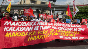 Demonstrators marching in manila Stock Photo