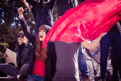 Demonstrators with red flag. Picture of young active demonstrators with red flag Royalty Free Stock Images