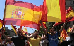 Demonstrators during  unity demosntration in barcelona. Demonstrators shouting slogans wearing spanish flags during a demonstration pro union of spain in Royalty Free Stock Photo