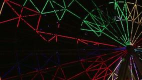 Demostración agradable de la luz de la noria en el vídeo de la noche almacen de metraje de vídeo