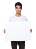 Demostración asiática del hombre con el tablero blanco Foto de archivo libre de regalías