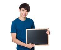 Demostración asiática del hombre con la pizarra Imagen de archivo