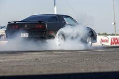 Demostración del humo en la pista Fotos de archivo libres de regalías