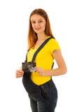 Demostración hermosa de la mujer embarazada con el bebé del ultrasonido en la parte posterior del blanco Fotos de archivo libres de regalías