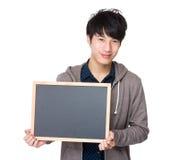 Demostración joven asiática del estudiante con la pizarra Imágenes de archivo libres de regalías