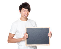 Demostración joven del estudiante universitario con la pizarra Imagenes de archivo