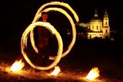 Demostración del fuego con la iglesia detrás Fotos de archivo libres de regalías