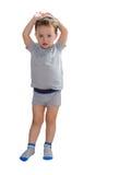 Demostraciones del muchacho cómo es grande él ha crecido Foto de archivo libre de regalías