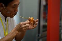 Demostraciones que moldean el azúcar de China Foto de archivo