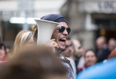 Demostrator with megaphone protesting against austerity cuts Stock Photo